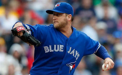 Toronto Blue Jays' Mark Buehrle pitches in the first inning of a baseball game against the Boston Red Sox in Boston, Saturday, May 11, 2013. (AP Photo/Michael Dwyer)
