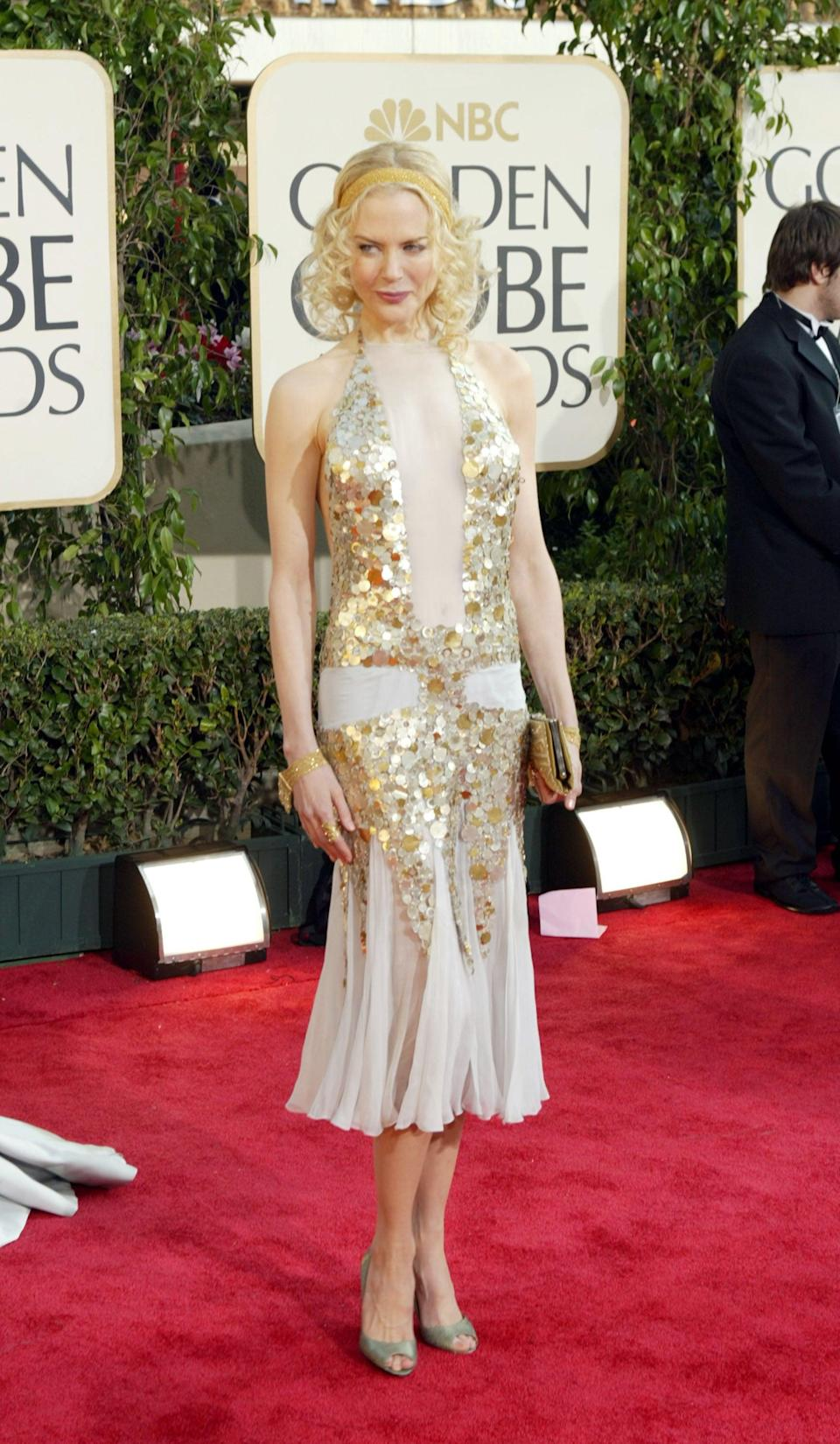 <p>Nicole wore Tom Ford to the 2004 Golden Globe Awards.</p>