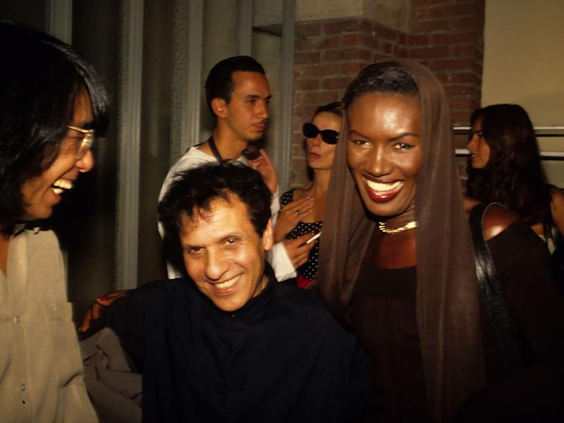 PARIS, FRANCE - OCTOBER 15: Kenzo Takada, Azzedine Alaia and Grace Jones attend An Azzedine Alaia fashion Show during Paris Fashion Week in the 1990s in Paris, France. (Photo by Foc Kan/WireImage)