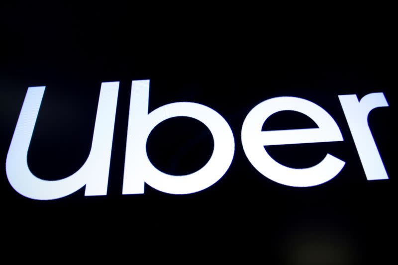 A screen displays the company logo for Uber Technologies Inc. on the day of it's IPO at the NYSE in New York