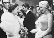 <p>Jayne Mansfield chose a gown with a high, beaded neckline when she met the Queen at a reception for the Royal Film Performance. The movie star's bling almost outshined the monarch's!</p>