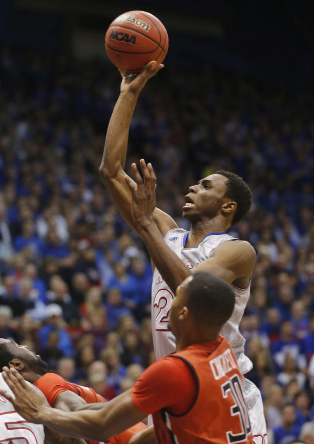 Kansas guard Andrew Wiggins (22) shoots over Texas Tech forward Jaye Crockett (30) during the first half of an NCAA college basketball game in Lawrence, Kan., Wednesday, March 5, 2014. (AP Photo/Orlin Wagner)