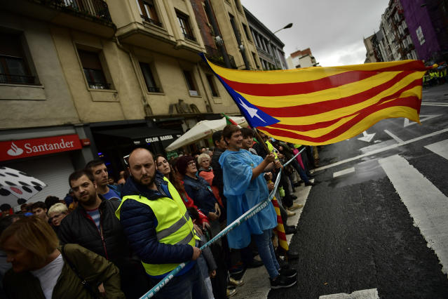"<p>A pro independence supporter waves an ""esteleda"", or Catalan pro independence flag, during a rally in support of the Catalonia's secession referendum, in Bilbao, northern Spain, Saturday, Sept. 30, 2017. Catalonia's planned referendum on secession is due to be held Sunday by the pro-independence Catalan government but Spain's government calls the vote illegal, since it violates the constitution, and the country's Constitutional Court has ordered it suspended. (Photo: Alvaro Barrientos/AP) </p>"