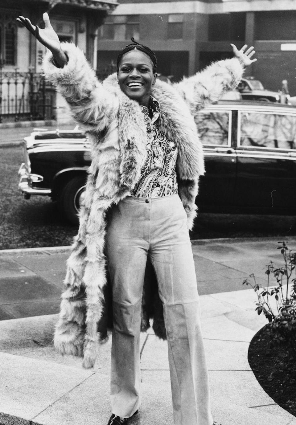 <p>During a visit to London, Tyson exudes joy while rocking a paisley shirt and fur.</p>