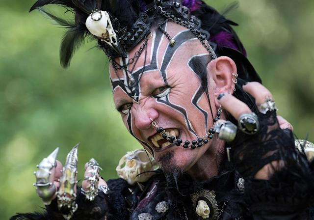 "<p>A participant of the so called ""Victorian Picnic"" performs in a fancy costume during the Wave Gothic Festival (WGT) in Leipzig, Germany, Friday, June 2, 2017. (AP Photo/Jens Meyer) </p>"