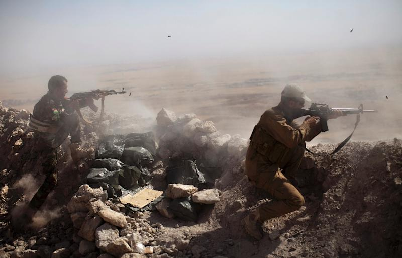 Iraqi Kurdish Peshmerga fighters fire at Islamic-State militant positions, near Mosul (AFP Photo/JM Lopez)