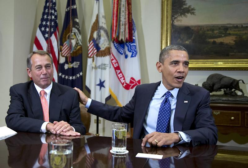 """FILE - In this Nov. 16, 2012, file photo, President Barack Obama acknowledges House Speaker John Boehner of Ohio while speaking to reporters in the Roosevelt Room of the White House in Washington, as he hosted a meeting of the bipartisan, bicameral leadership of Congress to discuss the deficit and economy. Congress appears far from reaching a deficit-reducing """"grand bargain"""" despite recent talk of charm offensives and less partisanship. The Senate's top Republican said Tuesday, March 12, 2013, that his party will push to trim Medicare and Social Security without yielding another dollar in new tax revenues.  (AP Photo/Carolyn Kaster, File)"""
