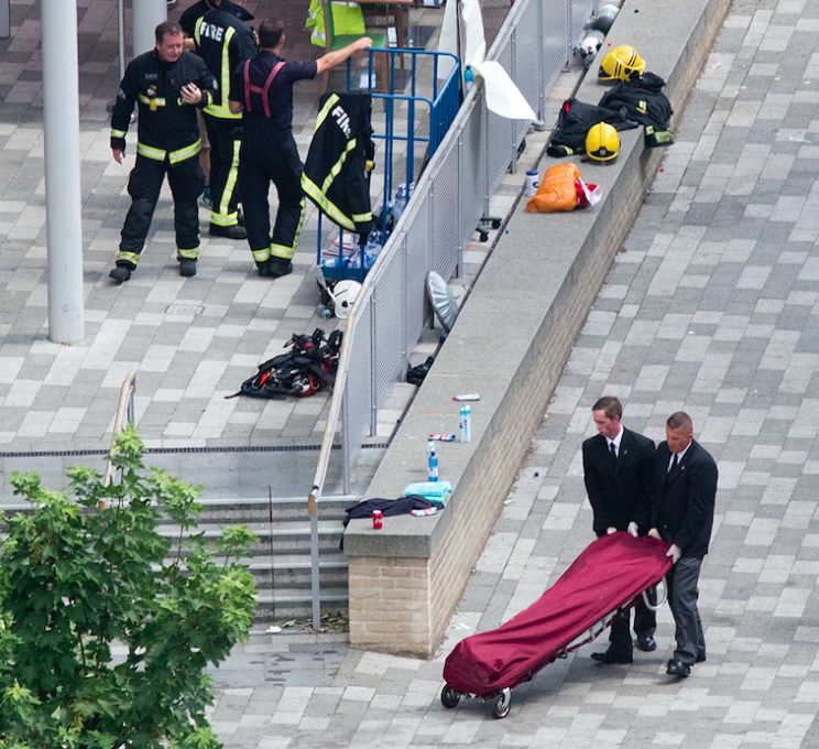 Bodies are being taken away as six people have so far have been confirmed to have died (PA)