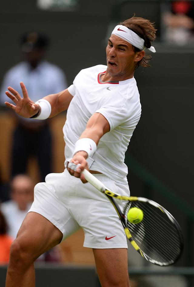 LONDON, ENGLAND - JUNE 24: Rafael Nadal of Spain plays a forehand during his Gentlemen's Singles first round match against Steve Darcis of Belgium on day one of the Wimbledon Lawn Tennis Championships at the All England Lawn Tennis and Croquet Club on June 24, 2013 in London, England. (Photo by Mike Hewitt/Getty Images)