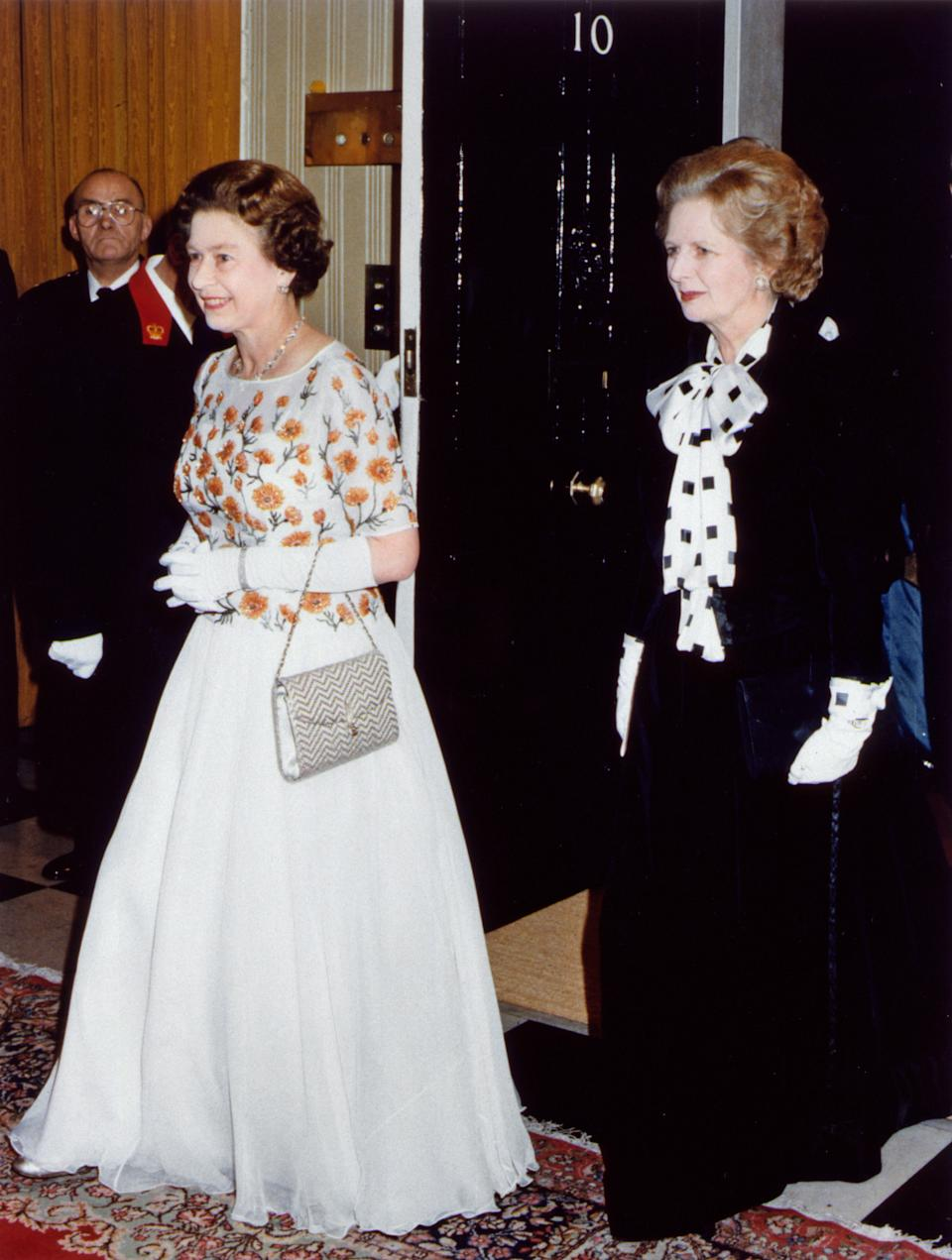 Her Majesty Queen Elizabeth II and Prime Minister Margaret Thatcher at Number 10 Downing Street wearing ball gowns December 1985. (Photo by Daily Mirror /Mirrorpix/Getty Images)