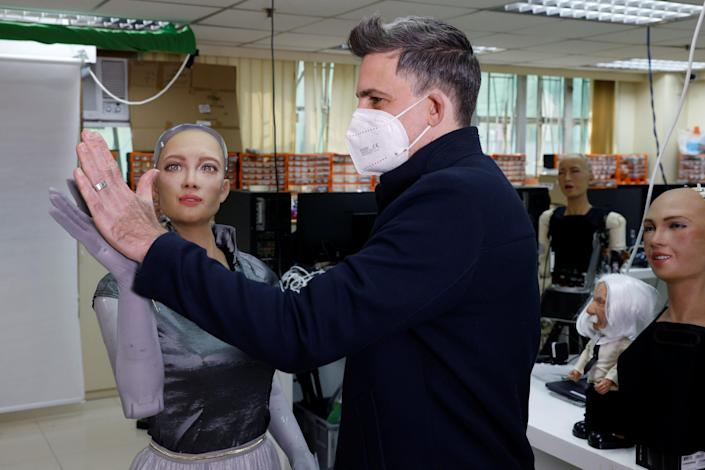 Hanson Robotics Founder Giving Sophia Robot a High Five.JPG