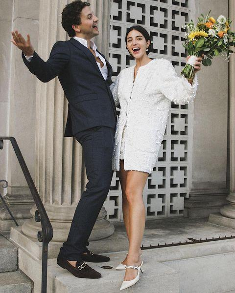 """<p>Smaller ceremonies and a carpe diem attitude are leading more brides away from the traditional maxi dress. </p><p>According to consumer shopping app <a href=""""https://about.liketoknow.it/"""" rel=""""nofollow noopener"""" target=""""_blank"""" data-ylk=""""slk:LiketoKnowit"""" class=""""link rapid-noclick-resp"""">LiketoKnowit</a> the search term 'short wedding dresses ' is experiencing a 1,500 per cent month on month (MoM) increase, while 'Bridal Jumpsuit' is seeing a 5,900 per cent MoM increase. Similarly, Lyst has seen a 170% increase in searches for mini bridal dresses. </p><p>'Midi and minis are where it's at this year.' Kaye concurs, adding: 'Brides are shying away from long dramatic gowns and are looking for more relaxed civil-appropriate silhouettes that they can rewear after the wedding day. </p><p>'We're also seeing more brides shunning the stiletto and pairing their midi / mini dresses with a flat shoe which is an interesting change up.'</p><p><a href=""""https://www.instagram.com/p/B4LAdGAlZqa/"""" rel=""""nofollow noopener"""" target=""""_blank"""" data-ylk=""""slk:See the original post on Instagram"""" class=""""link rapid-noclick-resp"""">See the original post on Instagram</a></p>"""