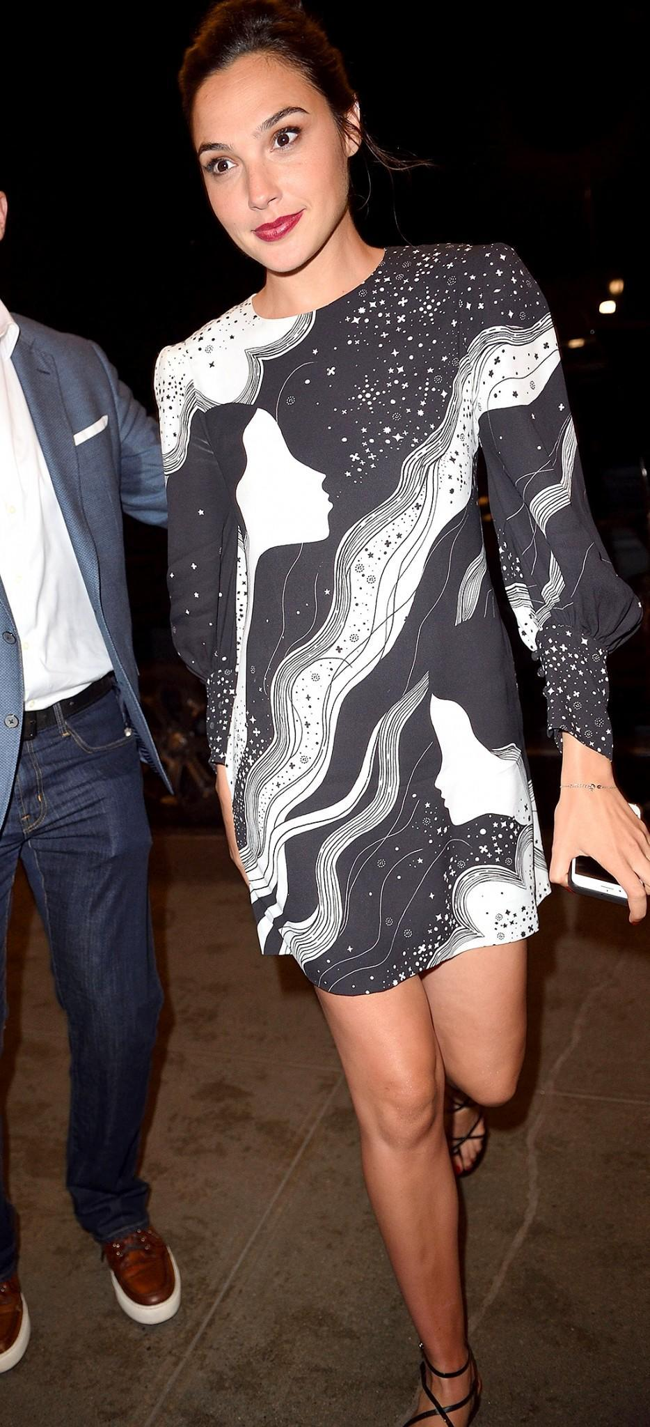 <p>Two days ahead of the movie's official release, Gadot created a frenzy when she attended a screening of the superhero flick in a black-and-white minidress that showed off all the time she had spent in the gym preparing for the role. She worked out six days a week for nine months leading up to shooting. Whew! (Photo: BACKGRID) </p>