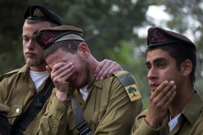 <p>Israeli soldiers from the Golani brigade mourn during the funeral of Sergeant Elichai Taharlev on Mt. Herzl Military Cemetery in Jerusalem, Thursday, April 6, 2017. Taharlev was killed after a Palestinian rammed his vehicle into a group of people in the West Bank. (Photo: Ariel Schalit/AP) </p>