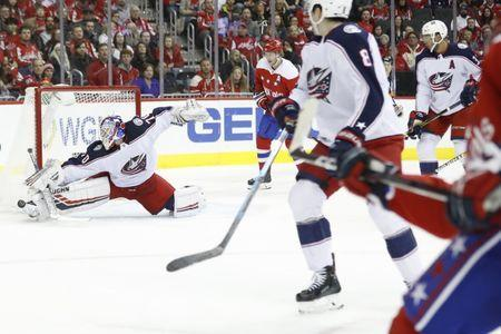 Jan 12, 2019; Washington, DC, USA; Columbus Blue Jackets goaltender Joonas Korpisalo (70) makes a save on Washington Capitals defenseman John Carlson (74) in the first period at Capital One Arena. Mandatory Credit: Geoff Burke-USA TODAY Sports
