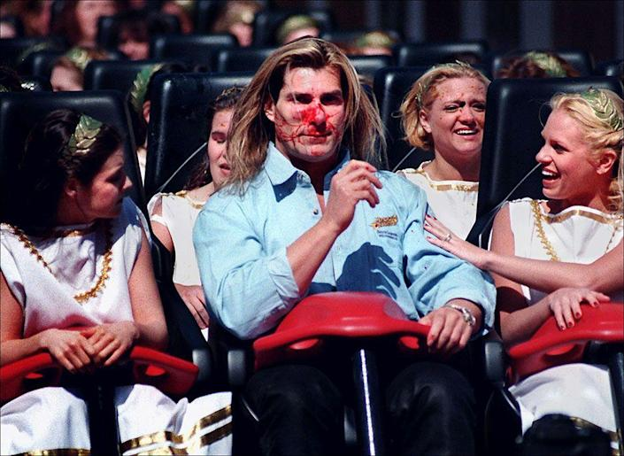 <p>We could never list celebrities on roller coasters without including our friend Fabio. The supermodel infamously got goosed at Busch Gardens Williamsburg in 1999 when a bird smashed into his face, at approximately 73 miles per hour, while he took the inaugural ride — along with more than 30 women dressed as goddesses (of course!) — on Apollo's Chariot hypercoaster. The romance novel model is very pretty, but it wasn't a pretty moment for him. (Photo: AP Photo/Virginian-Pilot, Steve Earley) </p>