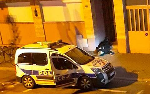 A dead body lays in the doorway of a building after a shootout with police in Strasbourg, eastern France, Thursday, Dec. 13, 2018.  - Credit: UGC