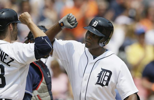 Detroit Tigers' Torii Hunter, right, is congratulated by J.D. Martinez after they both scored on Hunter's home run during the fourth inning of a baseball game against the Cleveland Indians, Sunday, July 20, 2014 in Detroit. (AP Photo/Carlos Osorio)