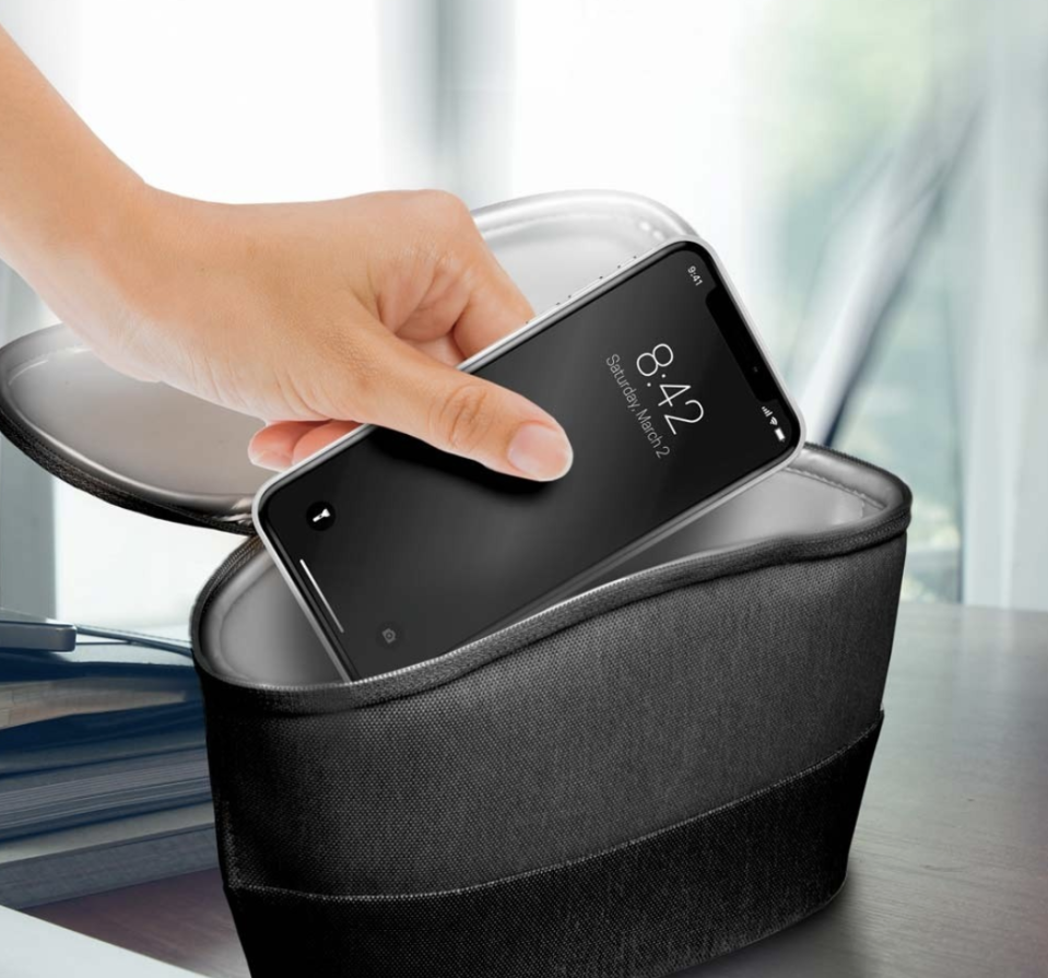 You can even tote this portable sanitizer like a purse. (Photo: Homedics)