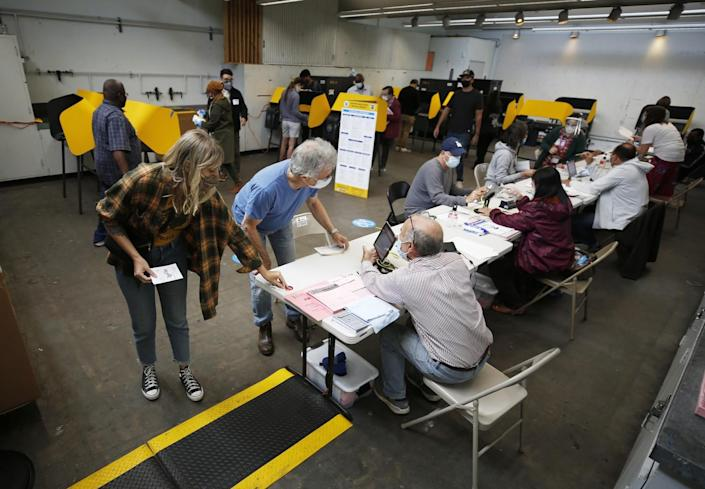 Voters check in with poll workers