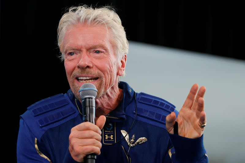FILE PHOTO: Billionaire entrepreneur Richard Branson wears his astronaut's wings at a news conference at Spaceport America