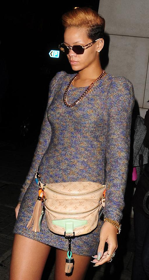 """Did we miss the memo? Are fanny packs back in style (not that they ever were)? If so, Rihanna should really rethink her hot mess of a hip bag. <a href=""""http://www.infdaily.com"""" target=""""new"""">INFDaily.com</a> - November 17, 2009"""