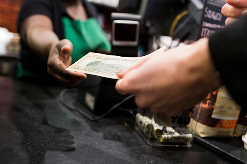 New York City businesses will be prohibited from refusing to accept cash payments of $20 or less under a bill that's expected to be passed on Thursday. (Photo: Astrakan Images via Getty Images)