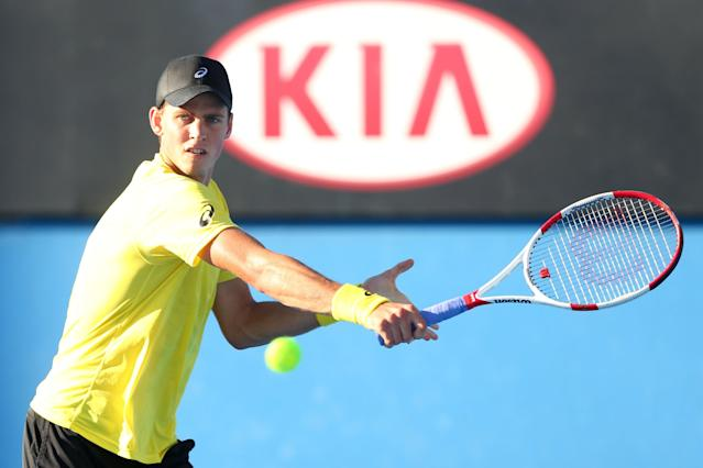 MELBOURNE, AUSTRALIA - JANUARY 13: Vasek Pospisil of Canada plays a backhand in his first round match against Samuel Groth of Australia during day one of the 2014 Australian Open at Melbourne Park on January 13, 2014 in Melbourne, Australia. (Photo by Quinn Rooney/Getty Images)