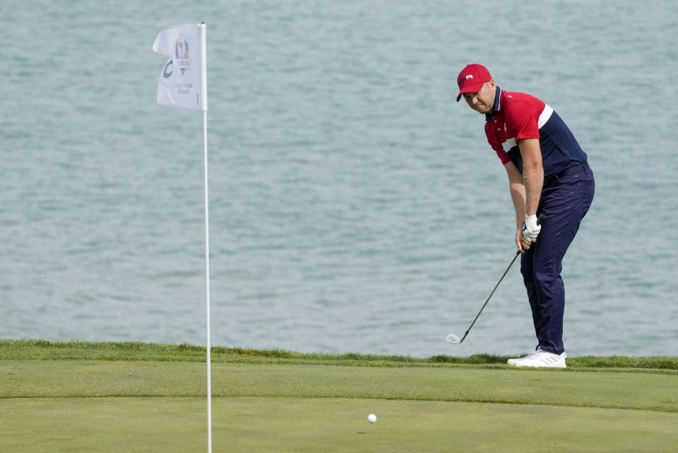Team USA's Daniel Berger hits to the third green during a Ryder Cup singles match at the Whistling Straits Golf Course Sunday, Sept. 26, 2021, in Sheboygan, Wis. (AP Photo/Charlie Neibergall)