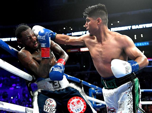 Mikey Garcia (R) lands as he defeats Robert Easter Jr. in their lightweight title unification fight at Staples Center on July 28, 2018, in Los Angeles. (Getty Images)