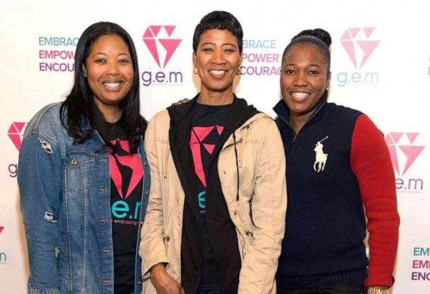 PHOTO: Brittany Barnett, far left, poses with her mother, center, and sister at an event for Girls Embracing Mothers (GEM), the charity she founded. (Courtesy Brittany Barnett)