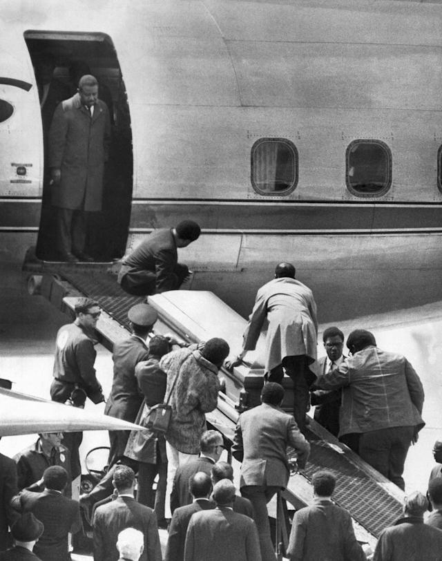 <p>The casket bearing the body of Dr. Martin Luther King, Jr., is taken up a loading ramp and placed aboard an airliner in Memphis, Tenn. for a trip to Atlanta, April 5, 1968. The Rev. Ralph Abernathy, named to replace Dr. King as head of the Southern Christian Leadership Conference, stands in the doorway of the plane. (Photo: AP) </p>
