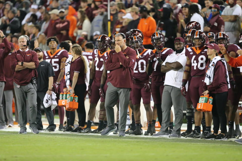 Virginia Tech head coach Justin Fuente watches from the sideline during the first half of an NCAA college football game against Notre Dame in Blacksburg, Va., Saturday, Oct. 9, 2021. (AP Photo/Matt Gentry)