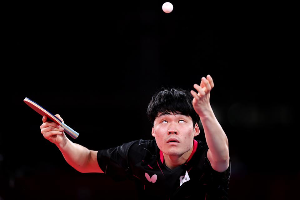<p>TOKYO, JAPAN - AUGUST 04: Jang Woo-jin of Team South Korea serves as he competes against China's Fan Zhendong during their men's team semifinal table tennis match on day twelve of the Tokyo 2020 Olympic Games at Tokyo Metropolitan Gymnasium on August 04, 2021 in Tokyo, Japan. (Photo by Naomi Baker/Getty Images)</p>