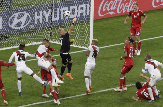 Denmark goalkeeper Kasper Schmeichel, center, makes a save during the group C match between Peru and Denmark at the 2018 soccer World Cup in the Mordovia Arena in Saransk, Russia, Saturday, June 16, 2018. (AP Photo/Gregorio Borgia)