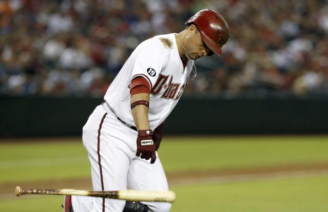 Arizona Diamondbacks' Martin Prado slams his bat down after flying out against the Colorado Rockies in the third inning of a baseball game on Friday, Sept. 13, 2013, in Phoenix. (AP Photo/Ross D. Franklin)