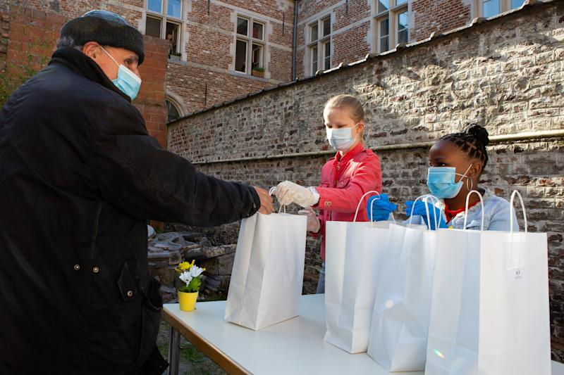 Princess Eleonore (C) wears a mouth mask against the spread of COVID-19, as she distributes food packages during a royal visit to the Kamiano restaurant of the homeless shelter of the Sant Egidio community in Brussels on May 14, 2020. (Photo by Alain ROLLAND / various sources / AFP) / Belgium OUT (Photo by ALAIN ROLLAND/BELGA/AFP via Getty Images)
