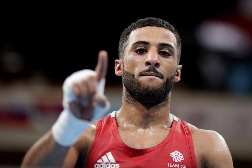Britain's Galal Yafai (red) celebrates after winning against Kazakhstan's Saken Bibossinov after during their men's fly (48-52kg) semi-final boxing match during the Tokyo 2020 Olympic Games at the Kokugikan Arena in Tokyo on August 5, 2021. (Photo by UESLEI MARCELINO / POOL / AFP) (Photo by UESLEI MARCELINO/POOL/AFP via Getty Images)