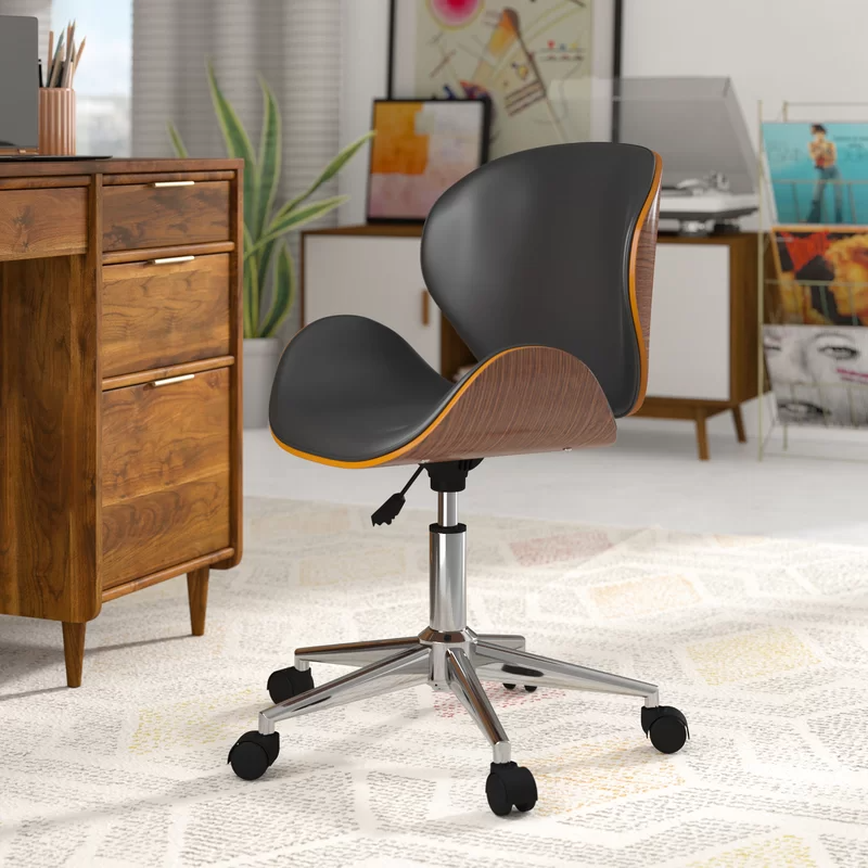 """<h2>George Oliver Brinkerhoff Task Chair</h2><br><strong>Best For: Style & Comfort </strong><br>This super sleek mid-century style task chair features a curved seat and back crafted from rounded wood and faux leather upholstery.<br><br><strong>The Hype:</strong> 4.7 out of 5 stars and 531 reviews on <a href=""""https://www.wayfair.com/furniture/pdp/george-oliver-brinkerhoff-task-chair-w000476546.html"""" rel=""""nofollow noopener"""" target=""""_blank"""" data-ylk=""""slk:Wayfair"""" class=""""link rapid-noclick-resp"""">Wayfair</a><br><br><strong>Comfy Butts Say: </strong>""""This chair went from being purchased to be more of a decorative piece in my home office to being my everyday office chair (work from home due to COVID-19). It handled the transition like a CHAMP. I was nervous about the design not being comfortable enough to handle 8-10 hours a day, but let me tell you, not only does it handle it, it forces me to have better posture when working, and in turn have less back pain than when I had a traditional office chair with more back support. I couldn't recommend it more; durable, stylish, comfortable, and promotes good posture. What more could you ask?""""<br><br><br><br><strong>George Oliver</strong> Bradford Task Chair, $, available at <a href=""""https://go.skimresources.com/?id=30283X879131&url=https%3A%2F%2Fwww.wayfair.com%2Ffurniture%2Fpdp%2Fgeorge-oliver-bradford-task-chair-golv1631.html"""" rel=""""nofollow noopener"""" target=""""_blank"""" data-ylk=""""slk:Wayfair"""" class=""""link rapid-noclick-resp"""">Wayfair</a>"""