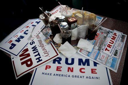 Signs for Republican presidential nominee Donald Trump are seen on a table during a Trump campaign stop at the Boulevard Diner in Dundalk, Maryland, U.S., September 12, 2016. REUTERS/Mike Segar
