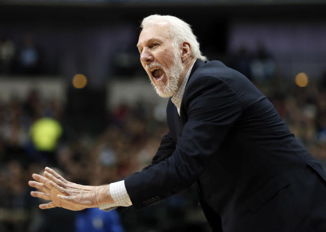 "<a class=""link rapid-noclick-resp"" href=""/nba/teams/sas/"" data-ylk=""slk:San Antonio Spurs"">San Antonio Spurs</a> head coach Gregg Popovich shouts in the direction of an official in the second half of an NBA basketball game against the <a class=""link rapid-noclick-resp"" href=""/nba/teams/dal/"" data-ylk=""slk:Dallas Mavericks"">Dallas Mavericks</a> on Tuesday, Dec. 12, 2017, in Dallas. (AP Photo/Tony Gutierrez)"
