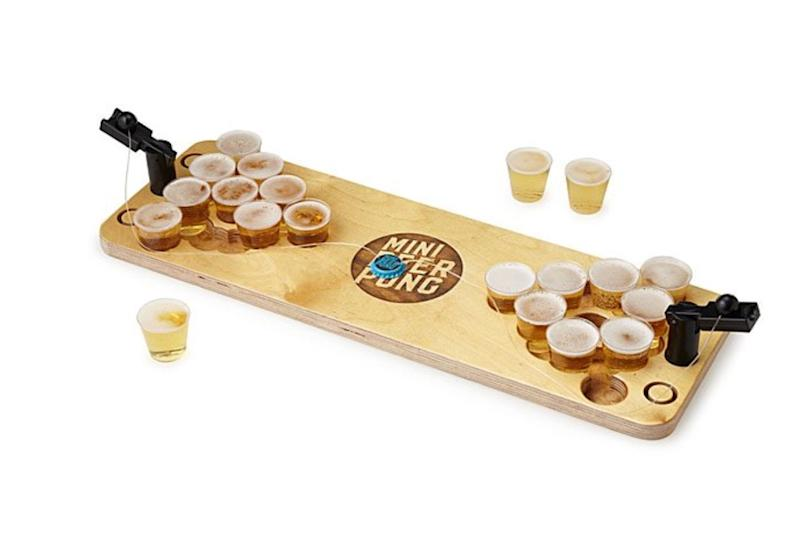 """If the beer lover in your life is a kid at heart, they'll appreciate this. Get it <a href=""""https://www.uncommongoods.com/product/mini-beer-pong"""" target=""""_blank"""" rel=""""noopener noreferrer"""">at Uncommon Goods</a> for $79."""