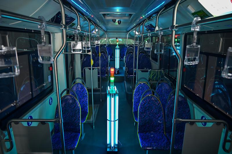 TOPSHOT - A bus has been disinfected with ultraviolet rays as part of measures against of the COVID-19 coronavirus in Shanghai on March 12, 2020 (Photo by Hector RETAMAL / AFP) (Photo by HECTOR RETAMAL/AFP via Getty Images)