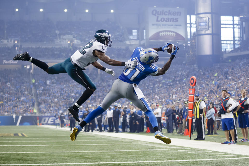 FILE - In this Nov. 26, 2015, file photo, Detroit Lions wide receiver Calvin Johnson (81), defended by Philadelphia Eagles cornerback Eric Rowe (32) , catches a pass for a touchdown during the second half of an NFL football game, in Detroit. Calvin Johnson is simply in awe that he will soon join Jim Brown and Gale Sayers as Pro Football Hall of Famers inducted at the age of 35 years old or younger. (AP Photo/Rick Osentoski, File)