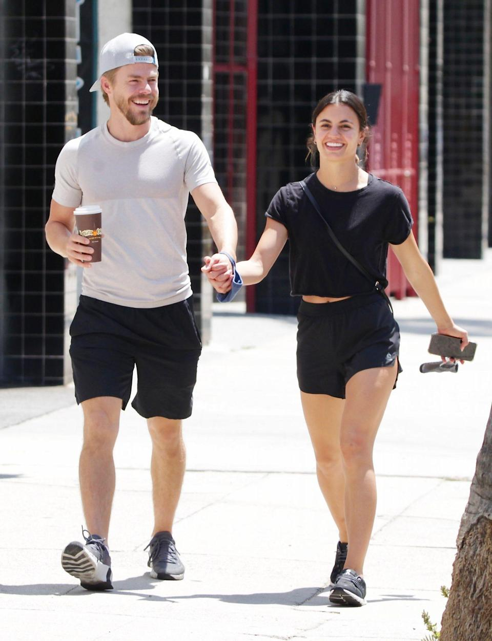 <p>Derek Hough and girlfriend Hayley Erbert are seen holding hands on their way to the gym in L.A. on July 18.</p>