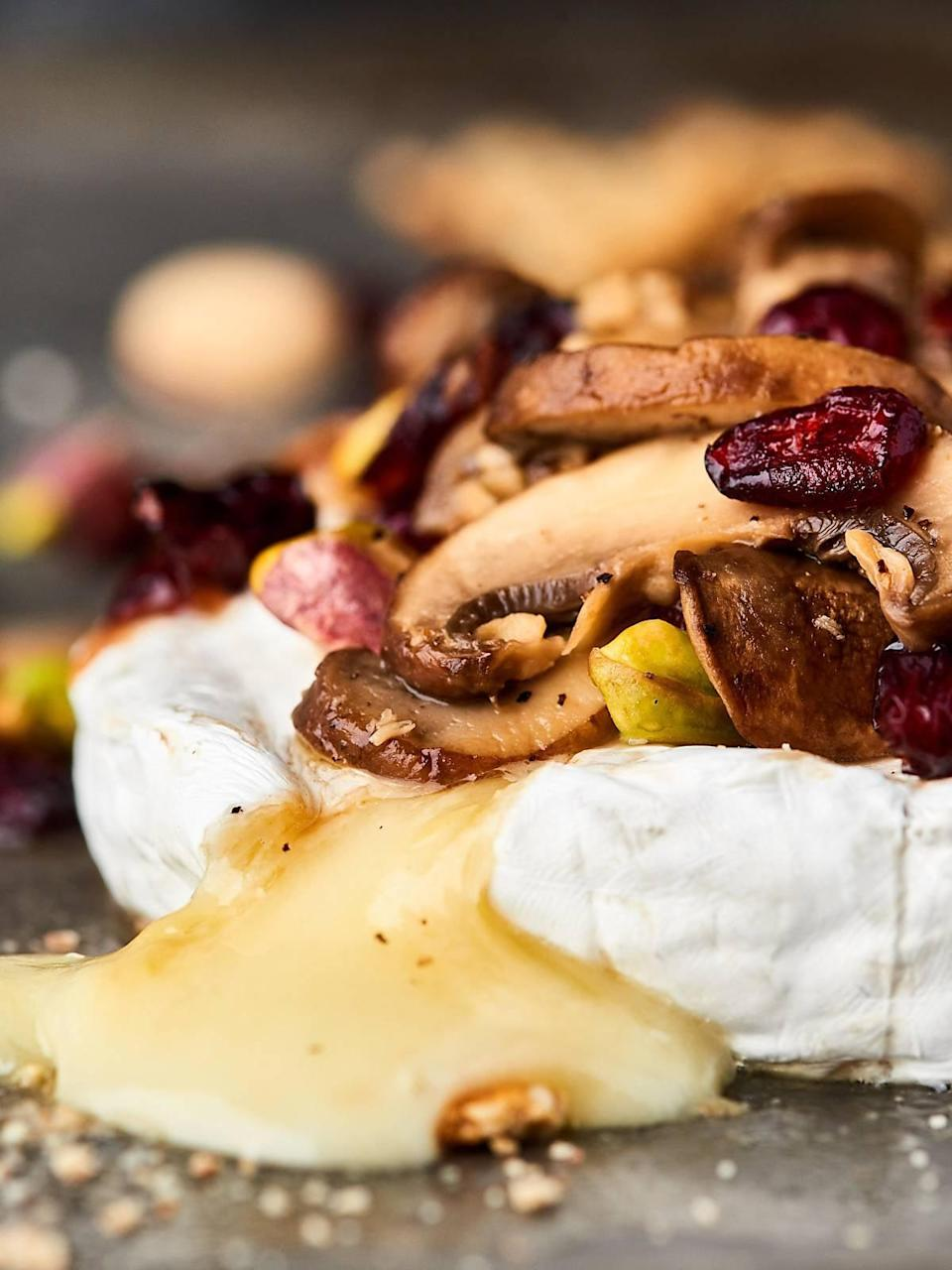 """<p>Mushrooms and brie go hand-in-hand to make this cheesy app one to remember. Warm cheese is topped with cooked mushrooms, nutty pistachios, and brut champagne, meaning this easy dish is not only impressive, but also easy to make.</p> <p><strong>Get the recipe</strong>: <a href=""""https://showmetheyummy.com/mushroom-brut-brie-recipe/"""" class=""""link rapid-noclick-resp"""" rel=""""nofollow noopener"""" target=""""_blank"""" data-ylk=""""slk:mushroom brut brie"""">mushroom brut brie</a></p>"""