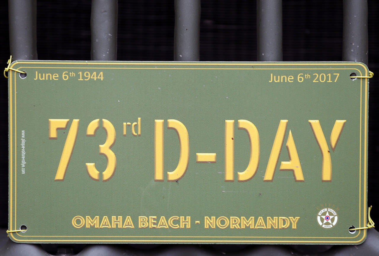 <p>A 73rd D-Day poster is seen during commemorations marking the 73th anniversary of D-Day on June 5 in Hiesville, France. Many people gather each year in Normandy to mark the anniversary of World War II's D-Day landing on June 6, 1944. (Photo: Chesnot/Getty Images) </p>