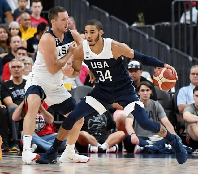 Jayson Tatum #34 of the USA Men's National Team is guarded by Pat Connaughton of the USA Men's Select Team in an intra-squad exhibition that was part of Team USA's preparation for the 2019 Basketball World Cup (AFP Photo/Ethan Miller)