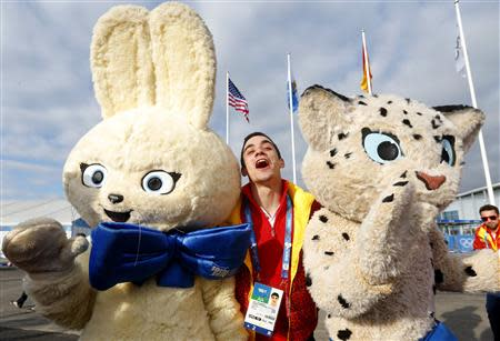 Spanish figure skater Javier Fernandez poses with Olympic mascots during the welcoming ceremony for the Spanish Olympic team in the Athletes Village at the Olympic Park ahead of the 2014 Winter Olympic Games in Sochi February 6, 2014. REUTERS/Laszlo Balogh