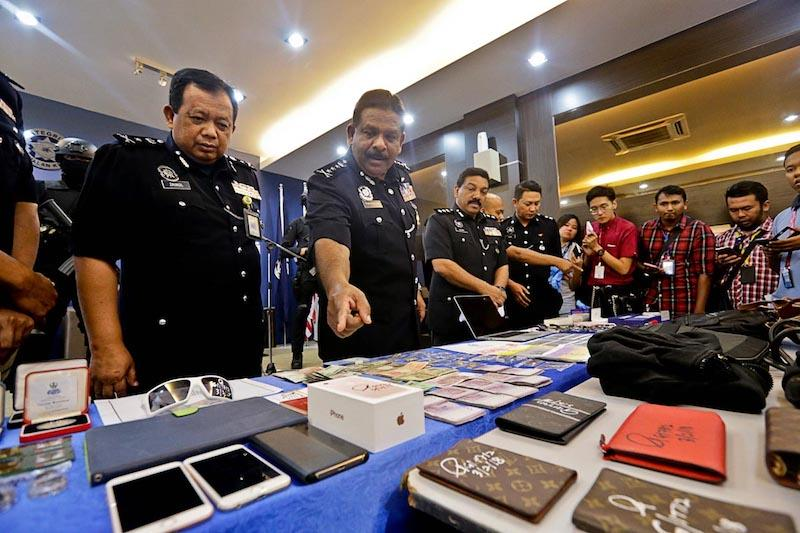Penang police bust RM1m burglary ring, hunt three more suspects